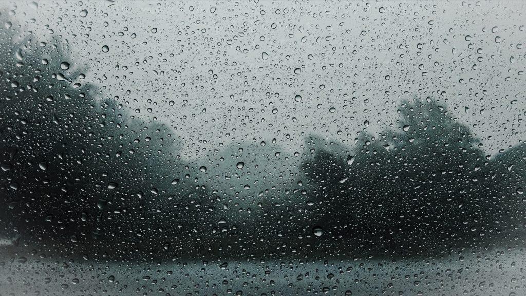 Haiku about Weather: Rain drops on a window